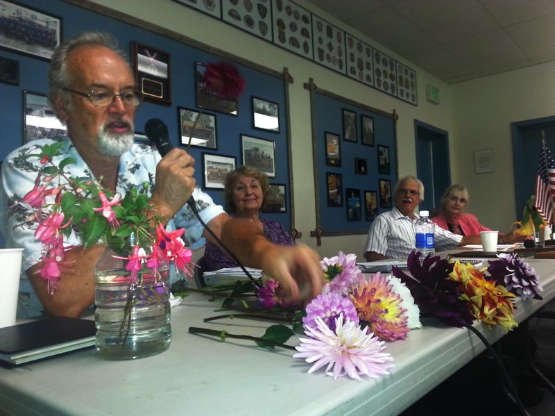 by: OUTLOOK PHOTO: CARI HACHMANN - Gary Law shows off his dahlias at the Columbian Garden Club meeting in Corbett.