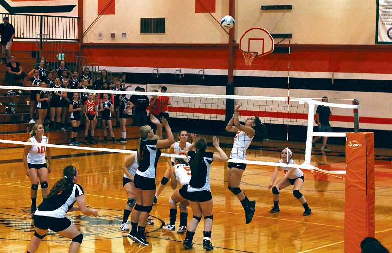 by: CORY MIMMS - Natalie Hobgood goes for the attack in Molalla's first league game of the season.