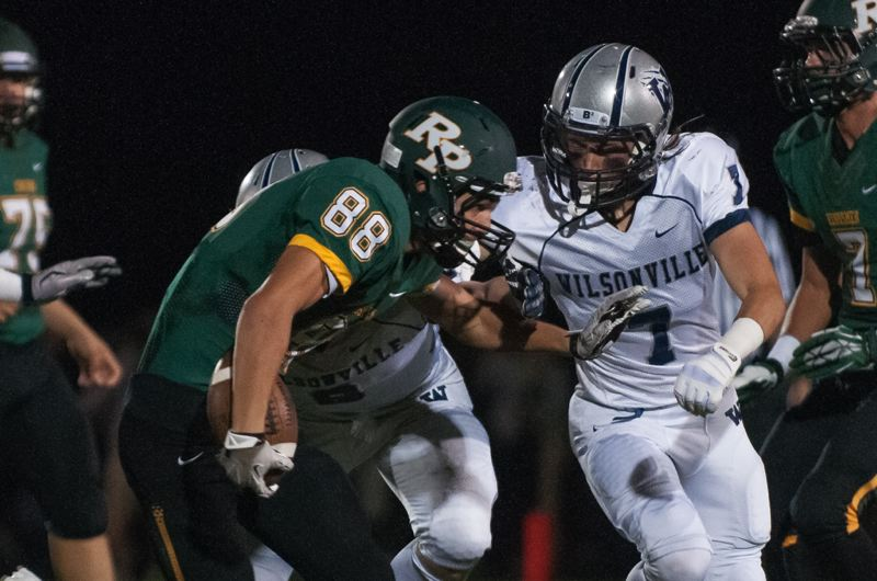 by: JOSH KULLA - Wilsonville defensive back Victor Oporta goes after Putnam receiver Friday in the Wildcats' 28-26 double overtime loss on the road. The Cats fall to 3-1 on the year, 1-1 in Northwest Oregon Conference play.
