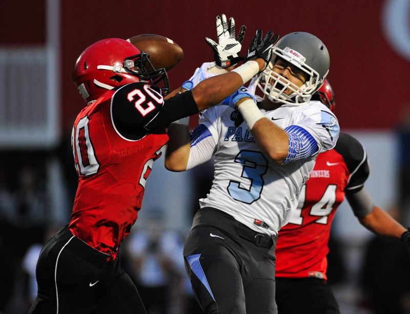 by: JOHN LARIVIERE - Oregon City linebacker Kiahve Dennis-Lee (20) says not on my watch as he breaks up a pass to Lakeridge star receiver J.R. McLaughlin in last Fridays 31-21 win over Lakeridge.