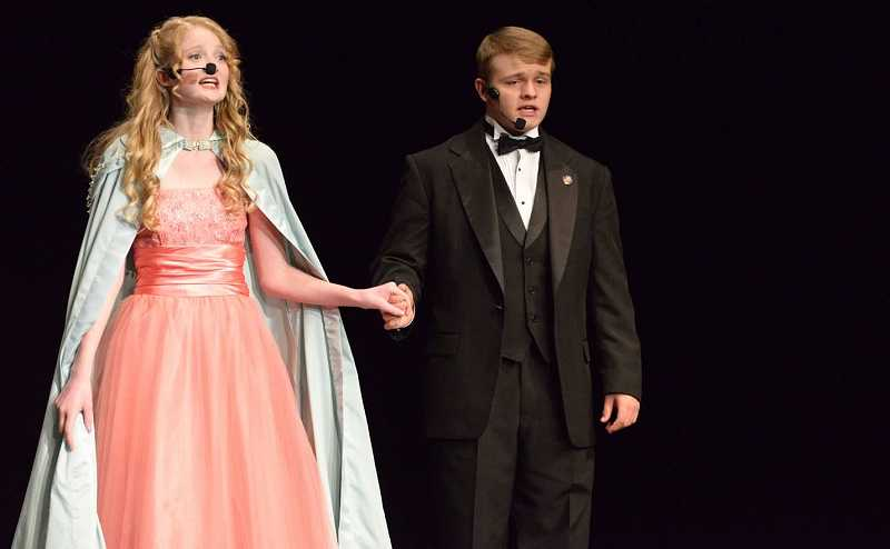 by: PHOTO BY ALEX BITZ - Erin Brookhart and Wyatt Moss singing at the 2013 Prineville Follies.
