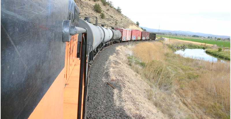 by: JASON CHANEY/CENTRAL OREGONIAN - At least three times a week, railway staff members haul freight back and forth down the winding tracks that connect the local freight depot to the Prineville Junction north of Redmond.