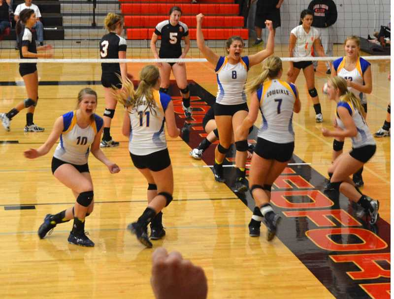 by: PHOTO COURTESY OF HEATHER FRASER - The Crook County Cowgirls celebrate following a block during the team's victory over Roseburg in the championship match of the Rogue Valley Invitational.