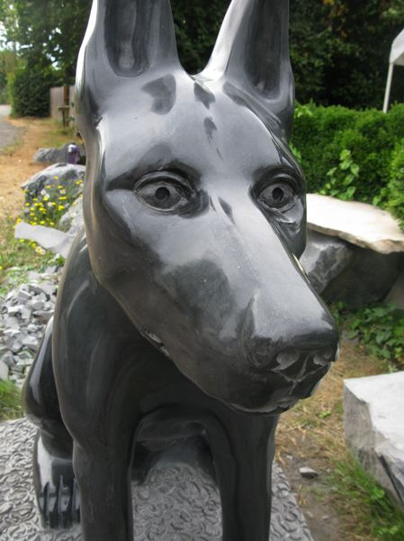 by: PHOTO BY: RAYMOND RENDLEMAN - Raising Kane is a black basalt sculpture to honor Kane, a police dog stabbed in the line of duty during 2011.
