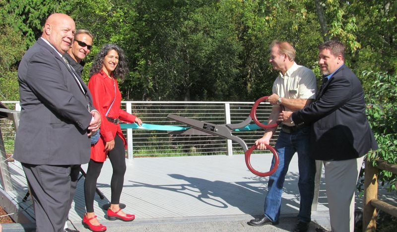 by: PHOTO BY ELLEN SPITALERI - Pictured from left are: Clackamas County Chair John Ludlow, Jeroen Kok and Mary Rose Navarro, natural areas grants coordinator. Far right, Milwaukie Mayor Jeremy Ferguson helps County Commissioner Paul Savas cut the ribbon.