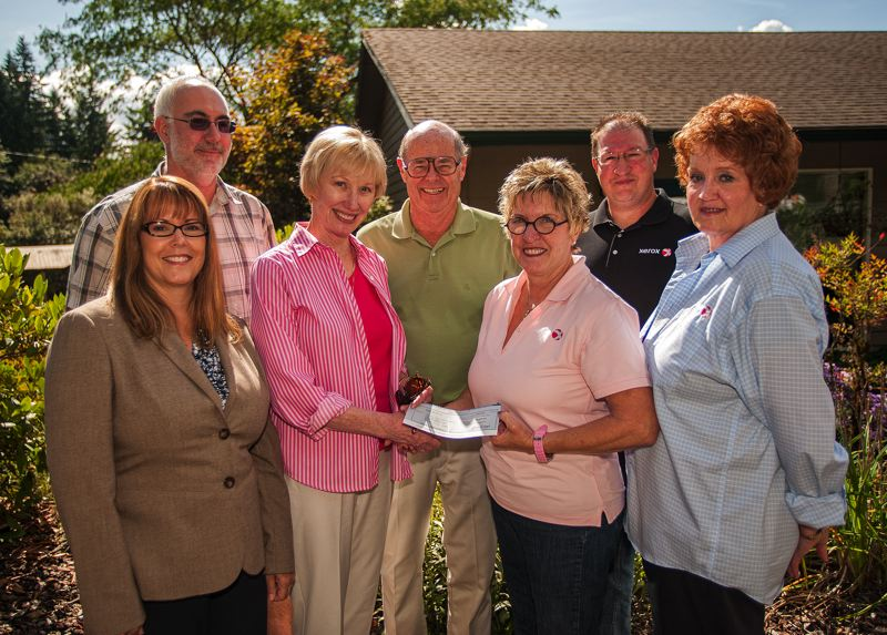 by: SPOKESMAN PHOTO: JOSH KULLA - Xerox employees, Parrott Creek staff and Parrott Creek board members gather at the ranch last week. From left, front, are Linda Winnett, Neil Davies, Donna Bane, Dick Spence, Kathy Jones, Garry Jones and Diane Adams.