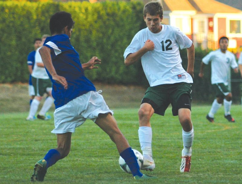 by: ESTACADA NEWS: PARKER LEE - Estacadas Tristan Thom tries to clear the ball out of the Rangers defensive zone during Thursdays loss to Madras.