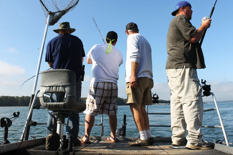 by: OUTLOOK PHOTO: CARI HACHMANN - Four men fishing for Chinook salmon on the Columbia River near the mouth of the Sandy.