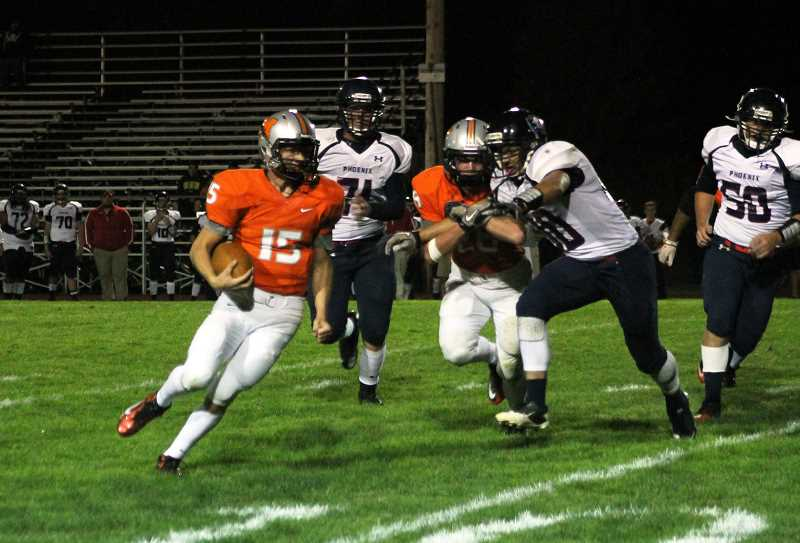 by: CORY MIMMS - Quarterback Austin Alexander runs through Pirates' defense.