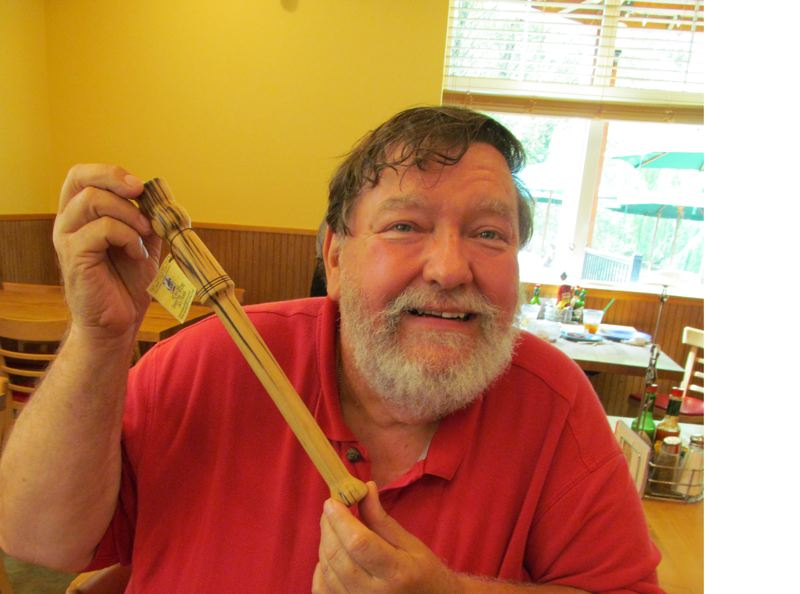 by: PHOTO BY: ELLEN SPITALERI - Tim Cebulla of the Medford area shows off his Oregon-wood spurtles at Bob's Red Mill in Milwaukie.
