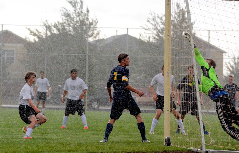 by: JOHN WILLIAM HOWARD - Coltin Willard (3) watches his shot sail through the rain and into the back of the net. Willard's goal was the first of three unanswered scores from the Indians on Tuesday afternoon.