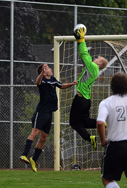 by: JOHN WILLIAM HOWARD - Junior goalkeeper Isaac Hamm intercepts a Banks pass in the second half of the Tribe's 3-1 victory on Tuesday afternoon.