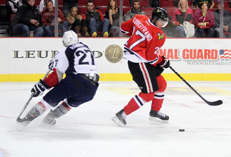 by: TRIBUNE PHOTO: JONATHAN HOUSE - Oliver Bjorkstrand of the Portland Winterhawks makes a move during Tuesday's home game versus Tri-City.