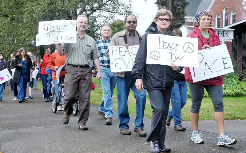 by: GARY ALLEN - More than two dozen people made the march from Memorial Park to Francis Square as part of International Peace Day.