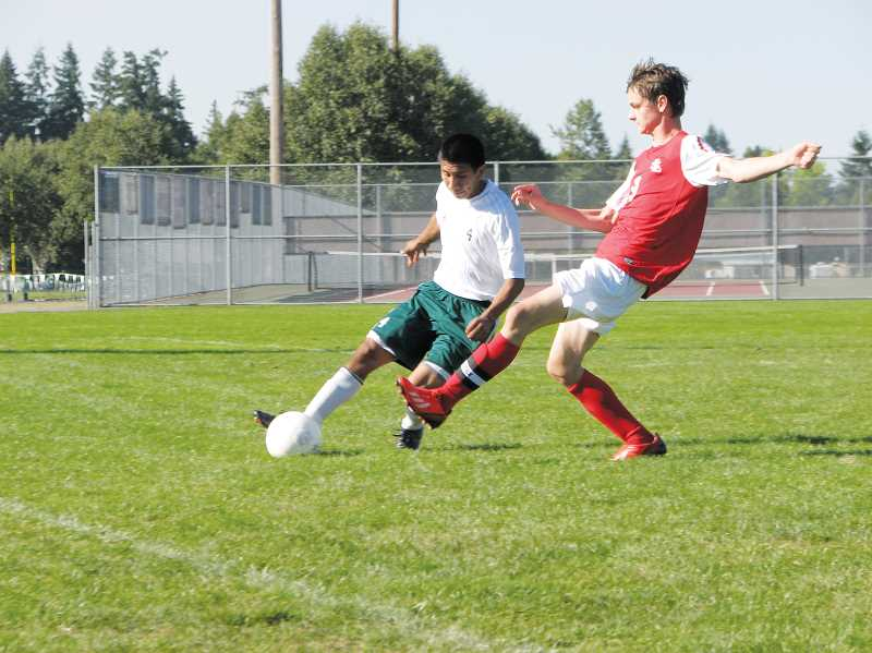 by: KYLE WHITEHEAD - North Marion defender Rodrigo Gonzalez works to keep the ball away from a La Salle player in the Huskies 1-0 loss to open the Tri-Valley Conference schedule Thursday.