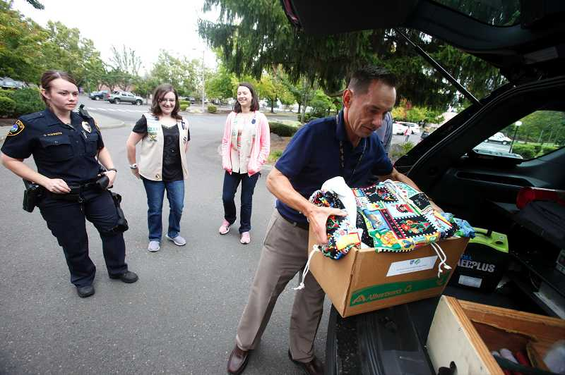 by: TIMES PHOTO: JONATHAN HOUSE - Girl Scouts Throw the Book at Tigard Police.