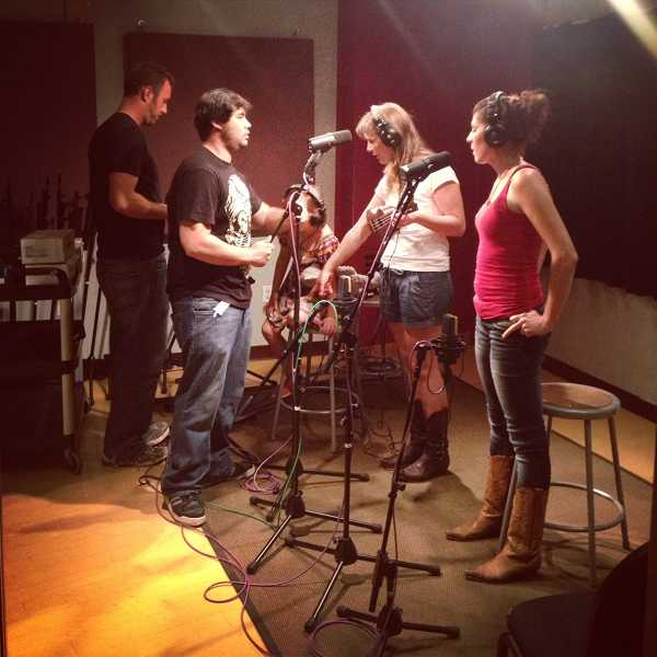 by: SUBMITTED PHOTO - Amelia Stanaway (hidden behind microphone), Amanda Stanaway and Jen Harlow (Predoehl) cut Stanaway's 'Indian Summer' in San Francisco recently.