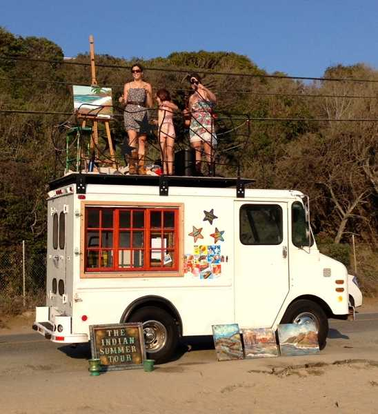 by: SUBMITTED PHOTO - Jen Harlow (Predoehl), Amelia Stanaway and Amanda Stanway perform atop an ice cream truck during a recent performance in Malibu, Calif.