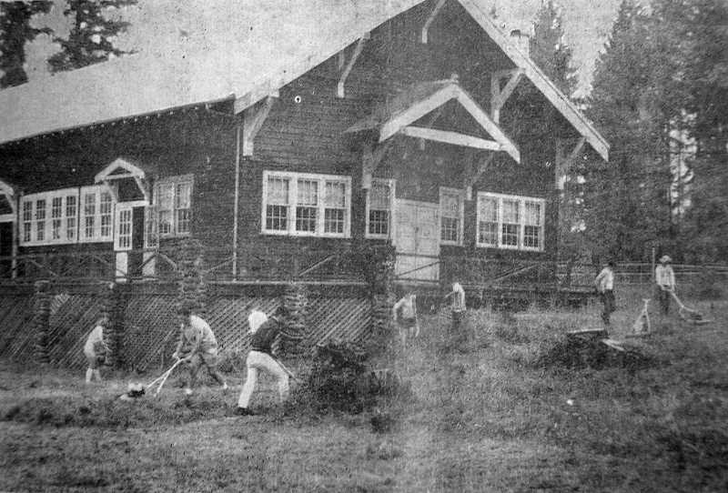 by: ESTACADA NEWS ARCHIVES - Teens worked to clean the grounds of the Armory Building. They planned to open a Teen Age Club in the building.