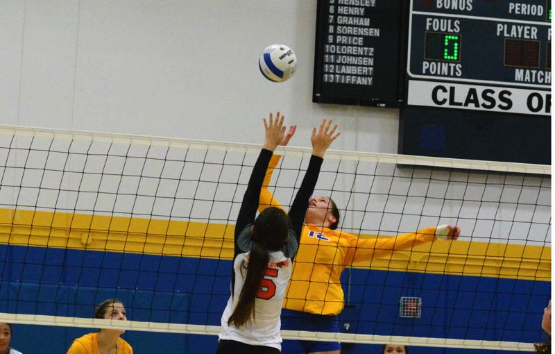 by: TIMES PHOTO: MATT SINGLEDECKER - Alohas Ciara Lambert leaps to take a crack at a kill attempt against Beaverton.