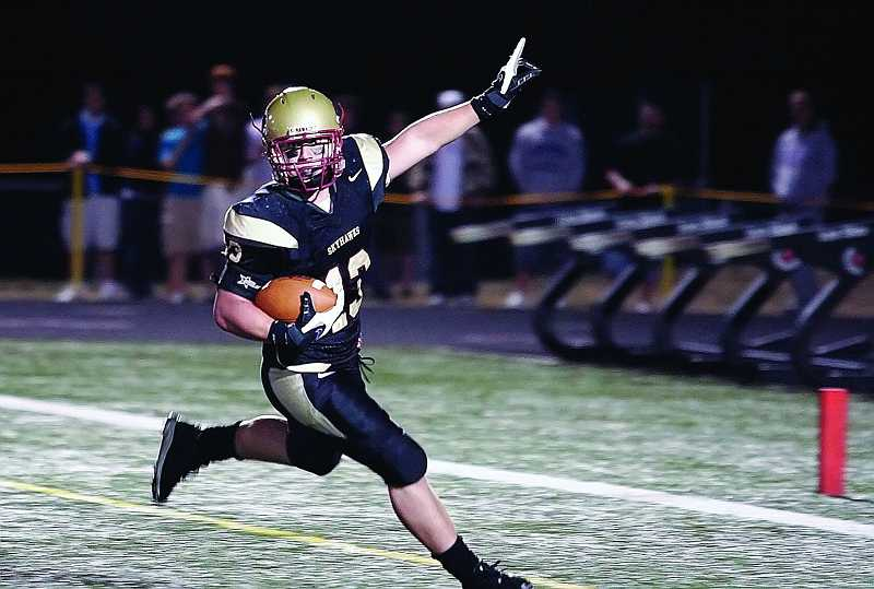 by: TIMES FILE PHOTO - Southridge High School retired the No. 13 jersey worn by both Pfc. Andrew Keller and his younger brother, Derek, last year after the 2008 graduate was killed in action while serving with the U.S. Army.