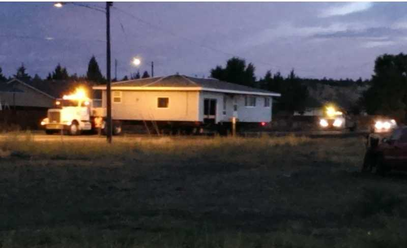 by: SUBMITTED PHOTO - The house was towed down Culver Highway before sunrise on Sunday.