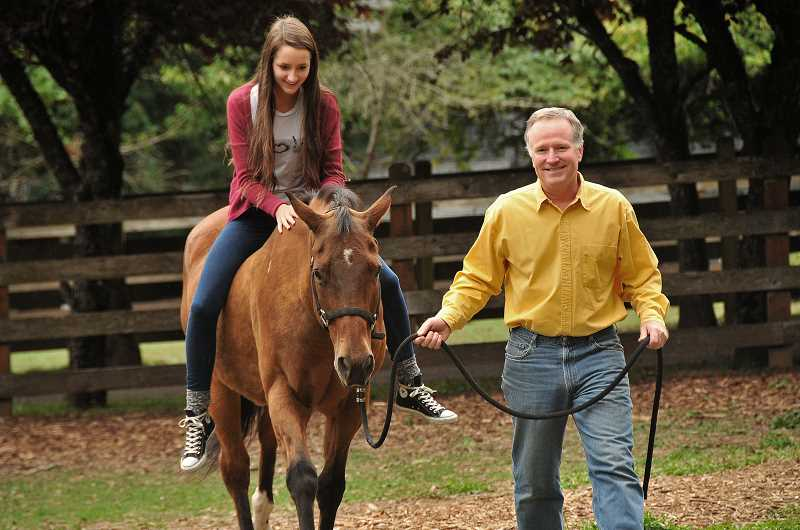 by: REVIEW, TIDINGS PHOTO: VERN UYETAKE - Like father, like daughter. Just 15 years old, Carolyn Connell is already following in the steps of her father, Evan Connell, by helping him prepare for his charity parties.