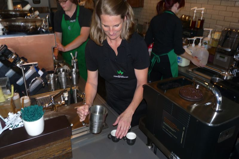 by: CONNECTION PHOTO: DREW DAKESSIAN - Multnomah Starbucks Store Manager Jennifer Gibson with coffee made with the new Clover brewing system.