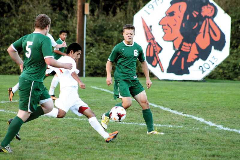 by: CORY MIMMS - Benito Ortiz-Mendoza slips through Estacada's defense.