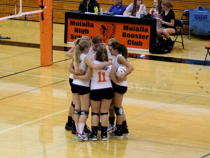 by: CORY MIMMS - The Indians pull together midway through a close first set.