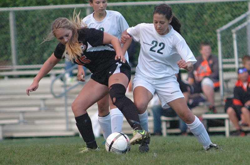 by: PARKER LEE - Leilani Lopes battles Estacada's Monica Wenlund for possession.
