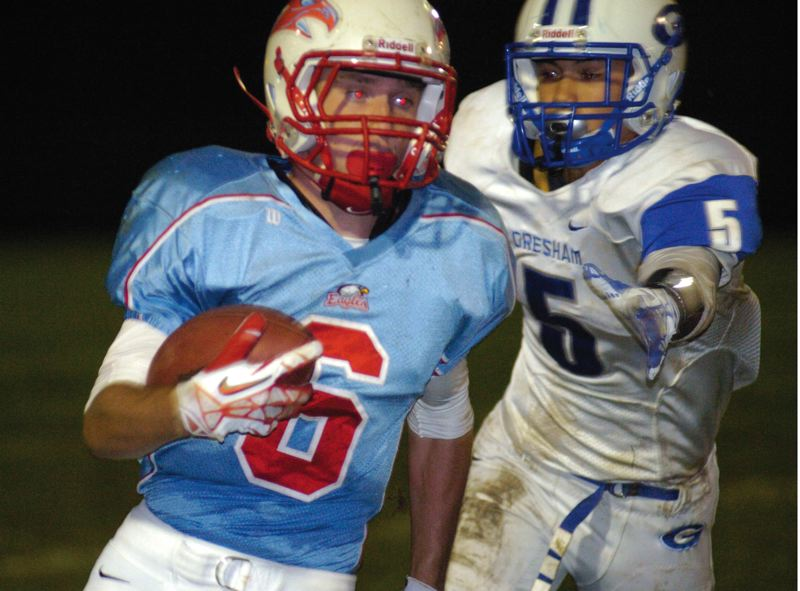 by: THE OUTLOOK: DAVID BALL - Centennial running back A.J. Wienke tries to get away from Gresham tackler Anthony Johnson during the Eagles 21-14 win Friday night.