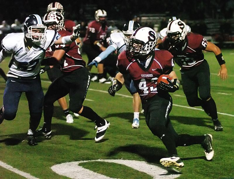 by: DAN BROOD - TURNING THE CORNER -- Sherwood senior halfback Tanner Shadbolt (43) sees running room during the Bowmen's 66-12 win over Liberty on Friday.