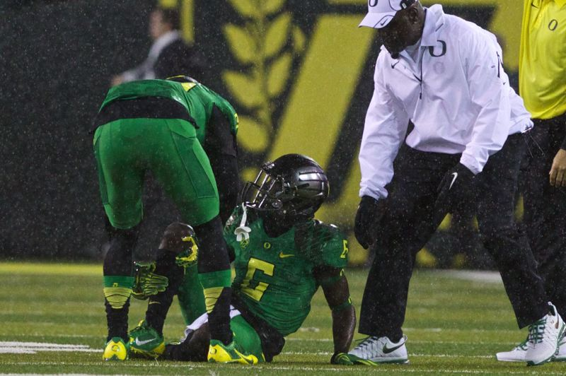 by: TRIBUNE PHOTO: JAIME VALDEZ - Oregon Ducks kickoff returner De'Anthony Thomas gets up slowly with an injury on the opening play in Saturday's home game versus Cal.