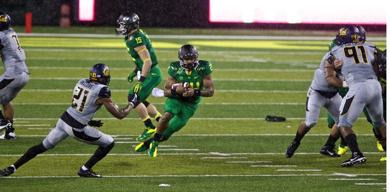 by: TRIBUNE PHOTO: JAIME VALDEZ - Freshman running back Thomas Tyner finds a hole in the Cal defense during Saturday's Oregon Ducks win, 55-16, in Eugene.