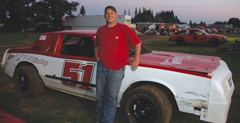 by: CONTRIBUTED PHOTO: MIKE WEBER - Sandys Ryan White shows off his car after winning the River City circuits Rookie of the Year award.