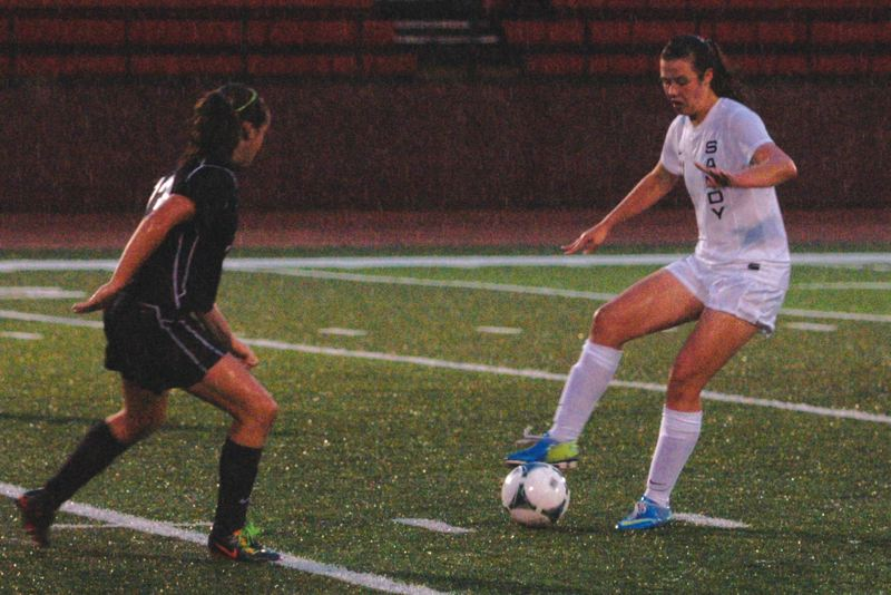 by: SANDY POST: PARKER LEE - Sandys Haley Kern settles a ball along the backline during the teams 7-0 loss to Tigard last week.