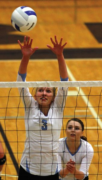 by: HILLSBORO TRIBUNE PHOTO: AMANDA MILES - Liberty senior Maryana Kuznetsova goes up for a block during Tuesday's NWOC match against Sherwood.