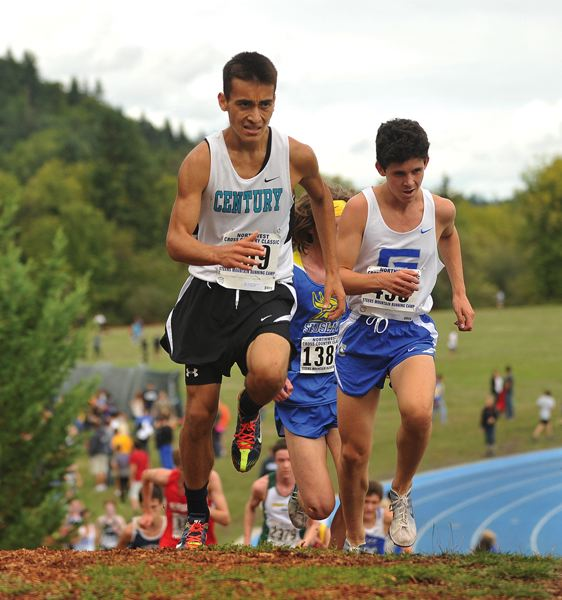 by: HILLSBORO TRIBUNE PHOTO: ZACK PALMER - Century sophomore Angel Salazar crests a hill during the Northwest Classic on Saturday at Lane Community College. Salazar finished 29th.