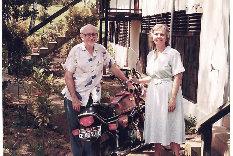 by: COURTESY OF BERT AND BETH FERRELL - LOCAL MODE OF TRANSPORTATION -- While Bert and Beth Ferrels practiced medicine in Borneo, Bert found using a motorcycle was the easiest way to get around.