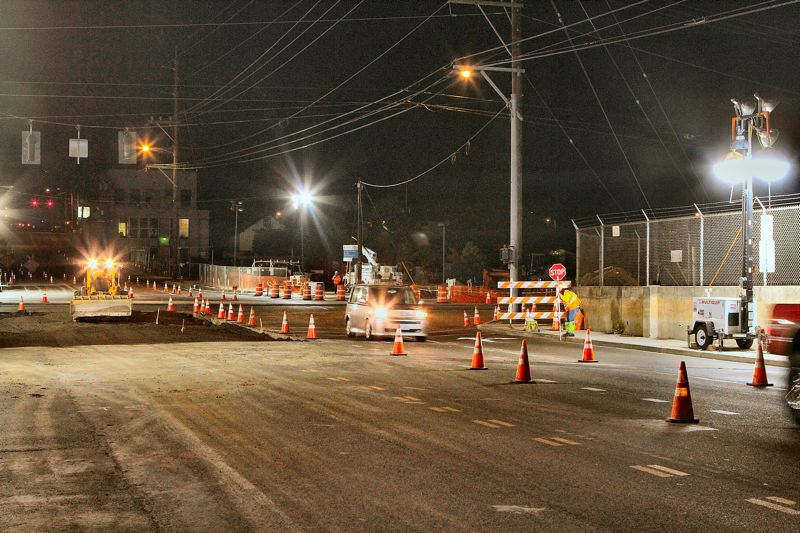 by: DAVID F. ASHTON - All through each night, from September 12 to 20, flaggers choreographed the movement of cars and construction vehicles as TriMet installed light rail track across the street, and rebuilt the Holgate-at-17th intersection.