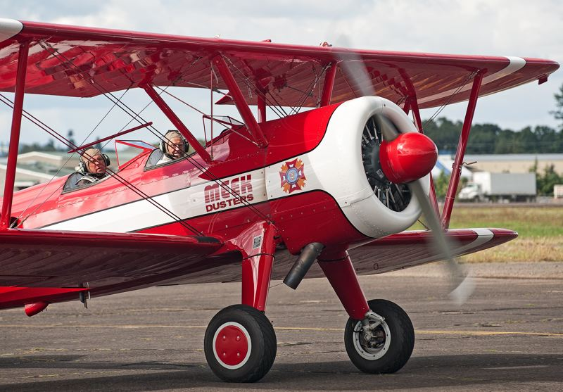 by: SPOKESMAN PHOTO: JOSH KULLA - Former B-24 bomber pilot Duane Buckmaster (front seat) and Ageless Aviation volunteer Wayne Cartwright (back) taxi back to Aurora Aviation, which hosted the Ageless Aviation Flight honoring Buckmasters service.