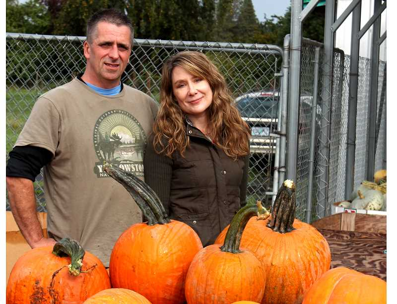 by: CORY MIMMS - John Searey and Gretchen Garcia. Pumpkins are just one fall harvest item they stock.