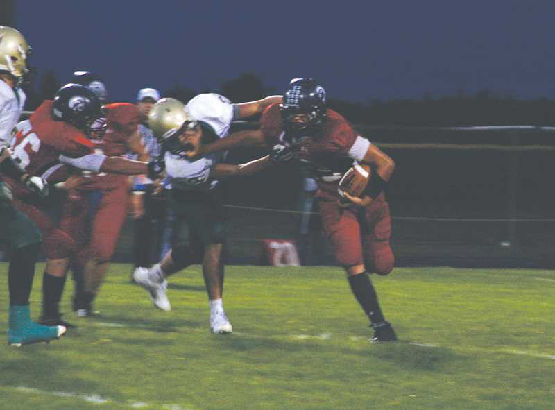 by: PHIL HAWKINS - Kennedy running back Ty Sawyer shrugs off a defender in the Trojans conference-opener against Regis Sept. 20. This week, Sawyer had a huge impact in Kennedys ground attack, picking up 138 yards and a pair of touchdowns on 10 carries in the teams 49-0 victory.