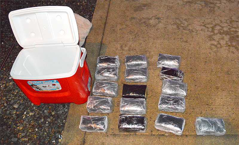 by: SUBMITTED PHOTO - Meth pulled from cooler in suspect's car.