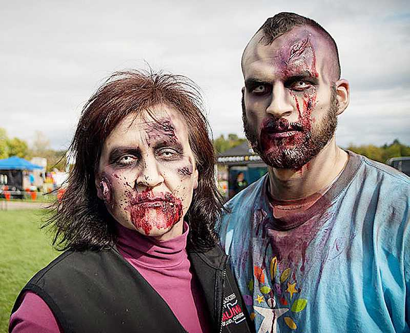 by: SUBMITTED PHOTO - Zombies -- The third annual Zombie Apocalypse fun run encourages participants to dress as zombies or survivors. This year the event will be held Oct. 12 at Heiser Farms in Dayton.