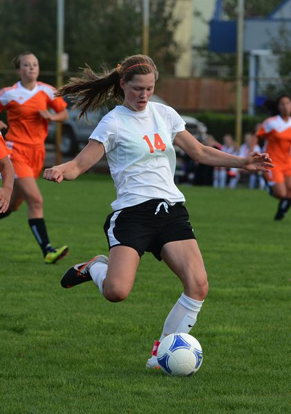 by: JOHN WILLIAM HOWARD - Scappoose sophomore striker Eleanor Jones takes aim during the first half of the Tribe's 7-0 victory over Yamhill-Carlton. Jones scored twice in the opening half.