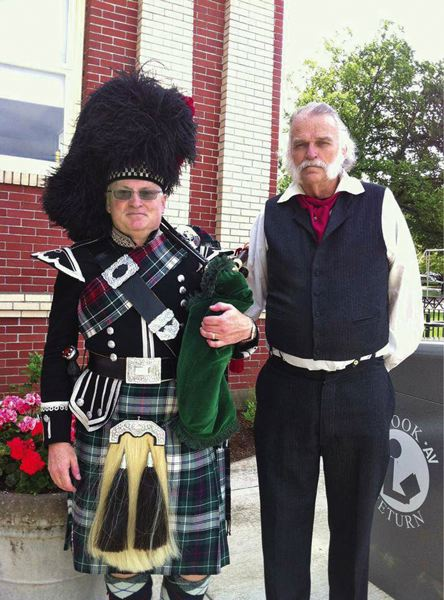 by: SUBMITTED PHOTO - Bagpiper Wiley Swogger and Mayor Doug Neeley (as Dr. John McLoughlin) stand in front of Oregon Citys Carnegie Library.