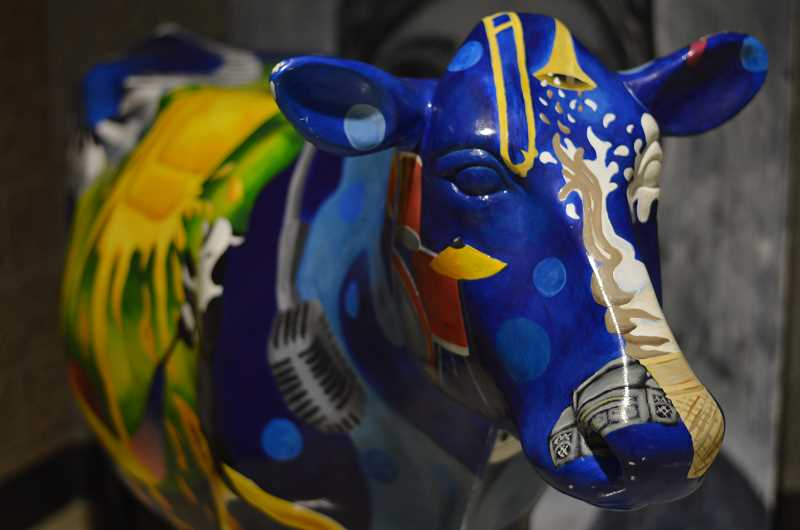 by: ROLLIN DICKINSON - A painted cow stands as a reminder of a Lakeridge students artistic skills.