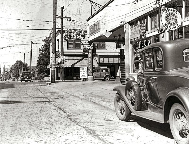by: PORTLAND CITY ARCHIVES - Looking north on S.E. 11th from Division Street - part of just one of the many commercial districts located in the  Hosford-Abernethy neighborhood. During the 1940s it was not uncommon to see an automotive garage or gas station on every busy intersection in Portland.